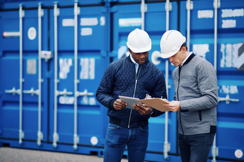 Two Construction Workers Reviewing Information