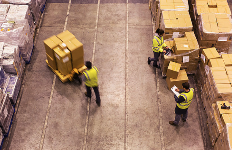 Warehouse Workers Moving Boxes