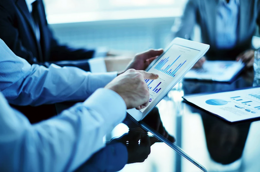 Businessman Pointing to Graph on Tablet