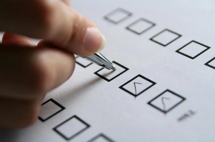 Person Adding Checks to a Checklist