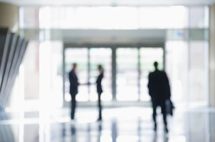 Blurred Image of Business People in Office Lobby