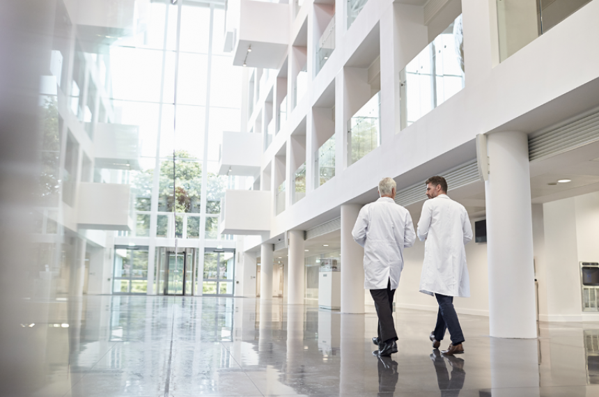 Two Doctors Walking In Building